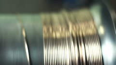 Goldsmith crafting precious metal wire with the help of rolling mill Stock Footage