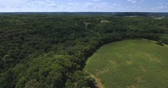 High Angle Aerial Over Woods and Farmlands of Pennsylvania   Stock Footage