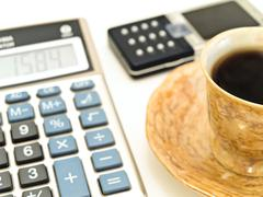 Coffee and Calculator Close up Stock Photos