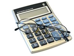 Calculator and Glasses Stock Photos