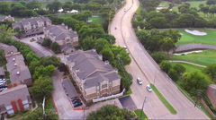 Fly Half Circle Over Road And Apartment Complex Stock Footage