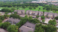 Fly Low Over Apartment Complex And Golf Course Stock Footage