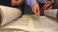 Jewish rabbi read Torah Stock Footage