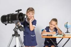 Two girls mysteriously astronomers thinking - stock photo