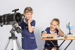 Girl mysteriously astronomer looks into the distance, a classmate with a smil Stock Photos