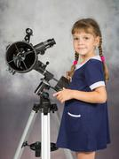 Girl lover of astronomy stands next to the telescope and looked into the fram Stock Photos