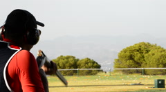 Man skeet shooter aiming and firing a rifle during a competition - stock footage
