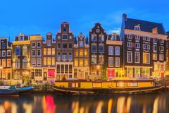 Amsterdam old buildings and Amstel river, Holland - stock photo