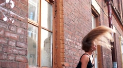 Woman flapping the hair at the Old Brick Wall - stock footage