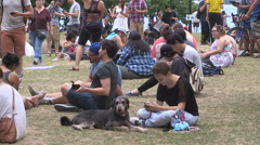 Toronto gamers playing Pokemon GO in city park Stock Footage
