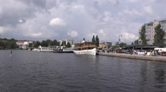 Savonlinna harbor and its close environs as seen from a departing boat Stock Footage