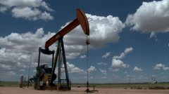 Timelapse clouds and oil pumpjack - stock footage