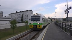 Local train departs from the station Stock Footage