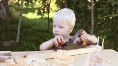 boy in the workshop of a carpenter planed wood planers  Stock Footage