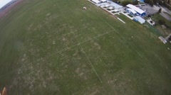 Skydiver landing on green field. Extreme sport. Adrenaline. Professional Stock Footage