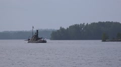 Cargo steamship Lauri sailis along Lake Saimaa Stock Footage