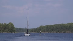 Sailing yacht heads to Saimaa open waters from Lappeenranta harbor Stock Footage