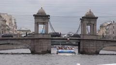 Pleasure boats on the Fontanka River pass under the Chernyshev Bridge Stock Footage