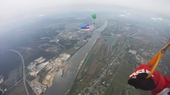 Skydivers fly in sky over green field. Colorful parachutes. Extreme. Balance Stock Footage