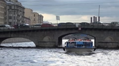 Pleasure boat passes under the Izmaylovsky Bridge / Fontanka River Stock Footage