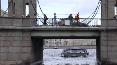 Pleasure boats on the Fontanka River pass under the Chernyshev Bridge Stock Footage