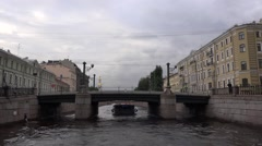 Pleasure boats pass between the two Mariinsky Opera buildings Stock Footage