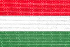 Flag of Hungary on brick wall texture background. Hungarian national flag. Stock Illustration