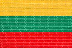 Flag of Lithuania on brick wall texture background. Lithuanian national flag. Stock Illustration