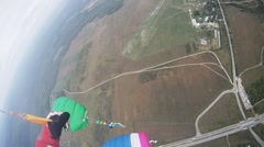 Skydivers fly in sky above ground. Colorful parachutes. Extreme. Professionals Stock Footage