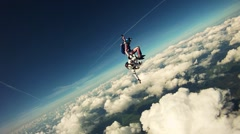 Skydiver freestyle in in cloudy sky. Extreme sport. Adrenaline. Height. Flight Stock Footage