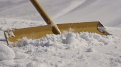 Men clear snow by shovel at ski resort. Sunny day. Mountain. Spraying. Snowdrift - stock footage