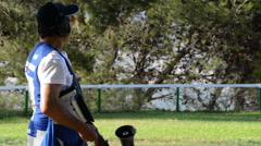 Shooter man aiming and shooting a rifle in a competition of skeet Stock Footage