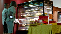 Motion of people buying cake inside Maxim's bakery Stock Footage