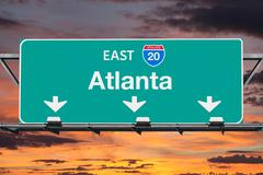 Atlanta Interstate 20 East Highway Sign with Sunrise Sky Stock Photos