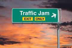 Traffic Jam Exit Only Freeway Sign with Sunrise Sky Stock Photos