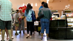 People line up for buying bread inside Maxim's bakery Stock Footage