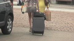 Women are carrying bags. Stock Footage