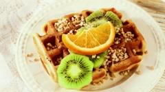 Belgian waffles with kiwi and orange Stock Footage