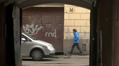 People walking near aged building. Stock Footage
