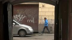 People walking beside aged building. Stock Footage