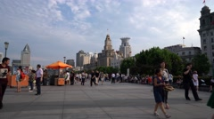 Tourists walking on the Bund, Shanghai China Stock Footage