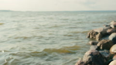 Girl sits on the coast and reading a book Stock Footage
