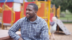 4K Portrait smiling father at outdoor adventure playground Stock Footage