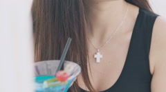 Close up of girl holding a goblet of cocktail and looking back Stock Footage