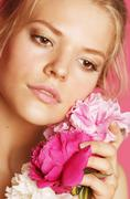 Young beauty woman with flower peony pink closeup makeup soft tender gentle look Stock Photos