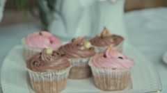 Plate with wedding cupcakes - stock footage