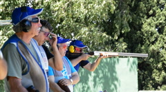Shooters shooting in skeet championship Stock Footage