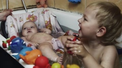 Happy little boy play with toys in bathtub. Baby swim in cradle. Water. Children - stock footage