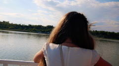 Back of girl looking at beautiful island from river ship arriving to the beach Stock Footage