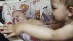Little boy play with toys in bathtub. Baby swim in cradle. Mother. Childhood - stock footage